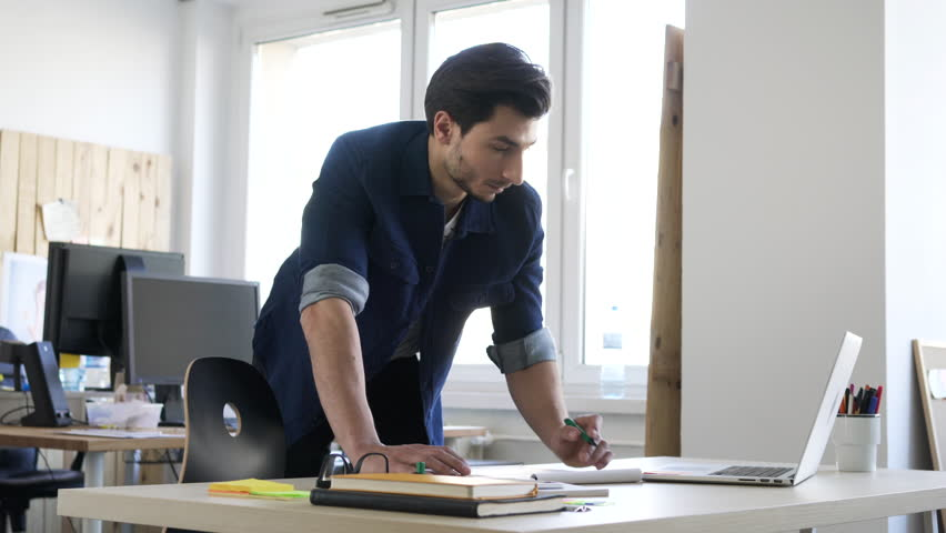 Handsome man, designer working in creative agency office.   Shutterstock HD Video #24287567