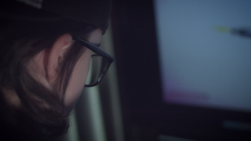 4K Close-up Child with Glasses Playing Video Game #24316343