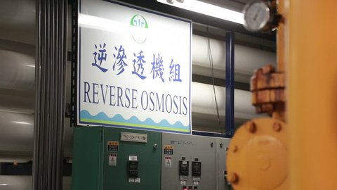 Penghu, Taiwan-03 November, 2014: Poster or sign of Reverse osmosis with Chinese characters in a water filtration plant in Penghu, Taiwan.