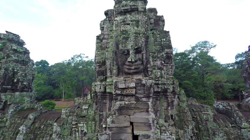 Stone tower with a human face. Cambodia Bayon temple. Video FullHD #24337436