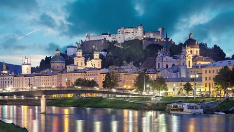 Salzburg skyline in the evening, Austria (Static image with animated sky and water)