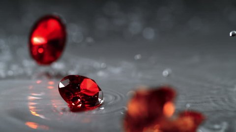 Ruby spinning on water surface. Shot with high speed camera, phantom flex 4K. Slow Motion.