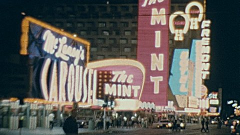 LAS VEGAS - 1965: casino signs at night in 1965 in Las Vegas