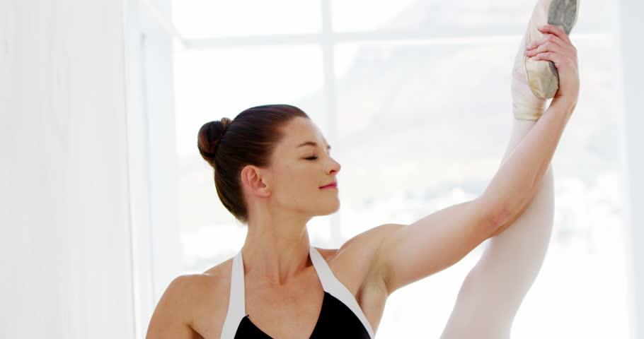 Ballerina practicing ballet dance in the studio #24396566