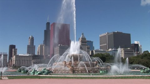 View of Buckingham Memorial Fountain flowing in the wind in Chicago United States