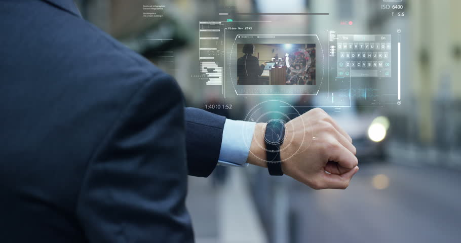 A businessman is followed by a conference on the economy and finance that appears in hologram clock futuristic and technological. Concept: network, conference, technology, augmented reality and future | Shutterstock HD Video #24409106