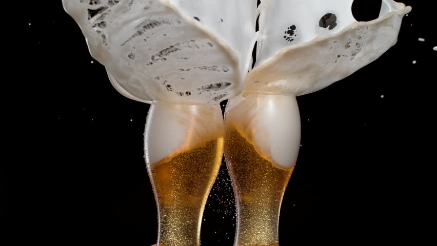 Having a toast with two glasses of beer and spilling. Shot with high speed camera, phantom flex 4K. Slow Motion. #24422726