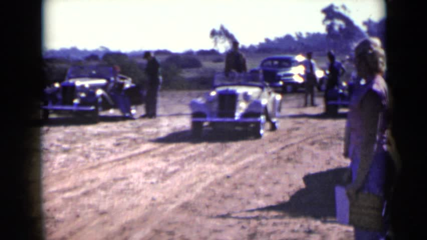 SAN DIEGO 1952: car stops for lady sign who is standing one side   Shutterstock HD Video #24446297
