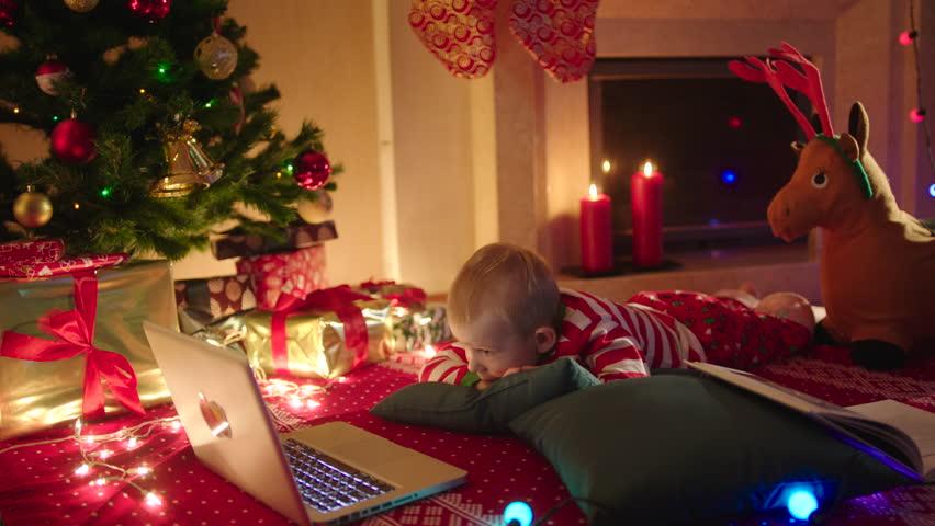 A Family On Christmas Eve Gathered Near A Fireplace. A Family ...