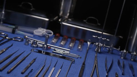 SURGICAL INSTRUMENTS NEATLY LAID OUT.  SLOW, DUTCH DOLLY MOVE ACROSS A SURGEON'S TOOLS PRIOR TO SURGERY.  SHOT IN 4K, 10 BIT, 4:2:2.