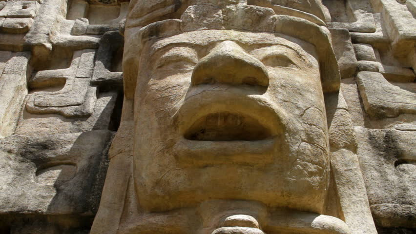 "Pan of a face on a Mayan Temple in Lamanai (""submerged crocodile"") in Belize"