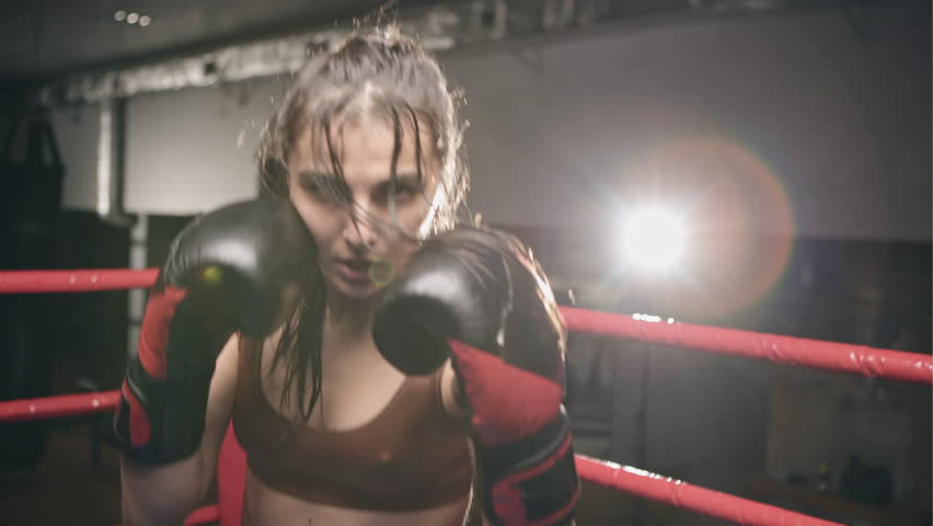 Fighter woman fist close up - boxer strikes into the side of the camcorder. Spectator video boxing | Shutterstock HD Video #24560147