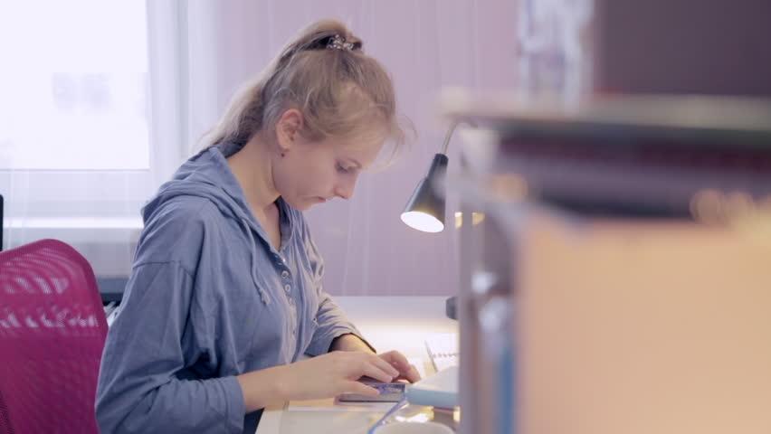 Teen Girl make homework using a smartphone | Shutterstock HD Video #24560276