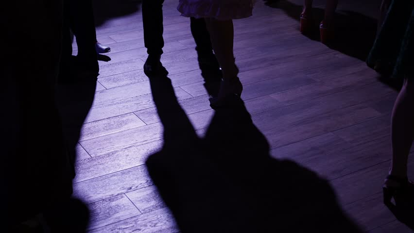 People dancing at the party shadows