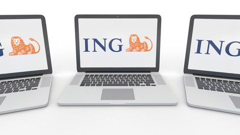 Notebooks with ING Group logo on the screen. Computer technology conceptual editorial 4K clip, seamless loop