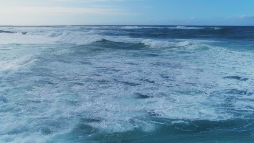 Aerial slow motion of beautiful sea waves. As the waves moves they create texture from white sea foam. Drone footage of seascape against sky.  | Shutterstock HD Video #24619943