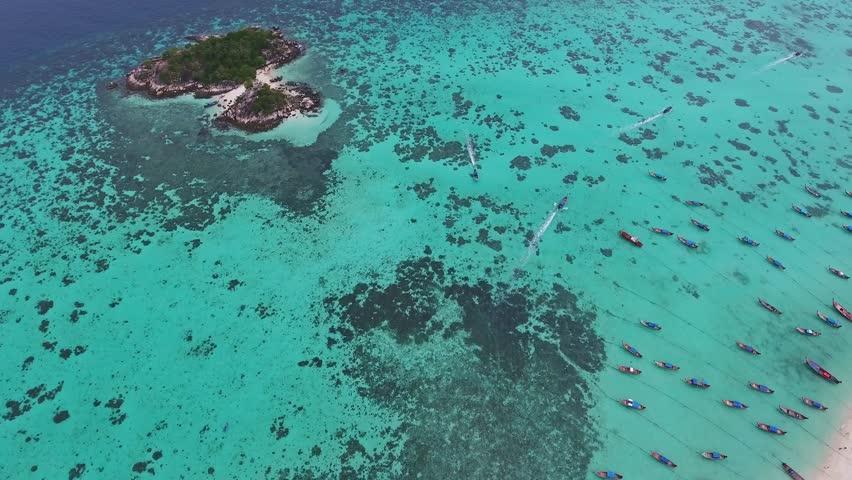 Aerial view on boats near tropical Ko Lipe island in the Andaman Sea, Thailand, 4k