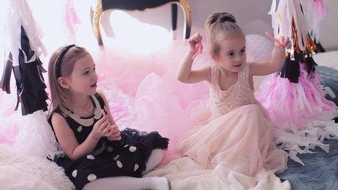 Little girls eating birthday liquorice