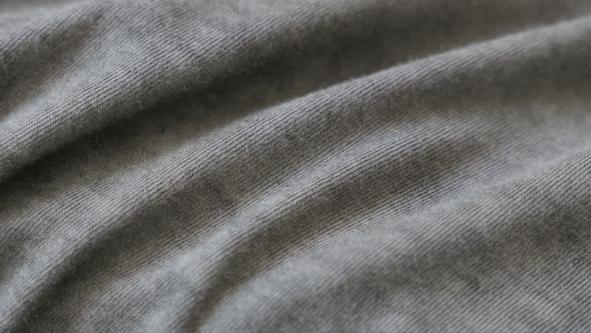 Silky gray modern clothing sample 2160p 30fps UltraHD  panning footage - Dark grey smoked color fine t-shirt fabric slow pan 4K 3840X2160 UHD video