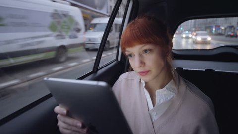 Woman in the Car Having a Tablet Skype Conversation