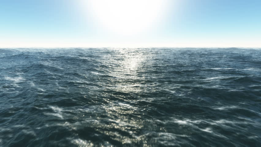 Ocean fly over,HD high speed animation just above the ocean waves facing the sun .