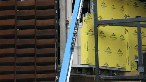 BROOKLYN, NY - FEBRUARY 15, 2012: Construction workers build the Barclays Center in Brooklyn, NY