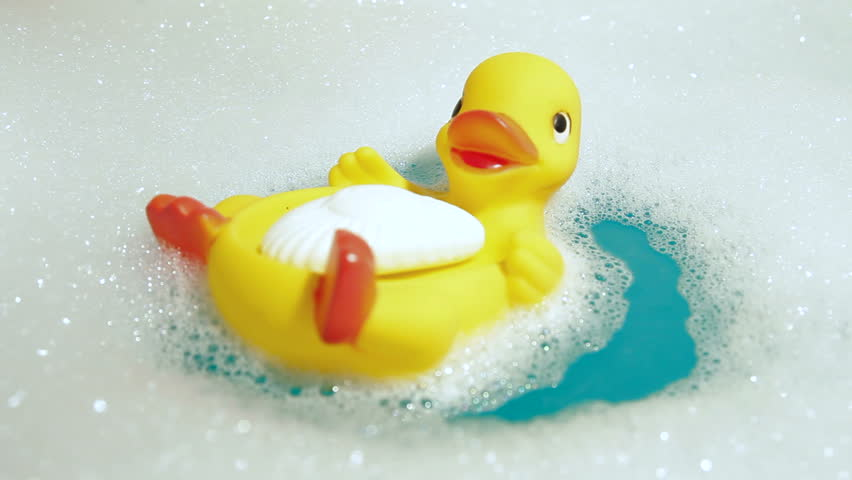 A Yellow Plastic Duck Floating In A Swimming Pool Filmed
