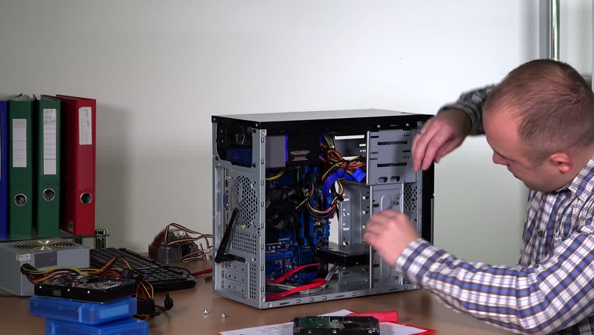 Professional computer repairer man upgrading computer hardware. Guy installing ram memory to desktop pc. Static shot. 4K | Shutterstock HD Video #24784706