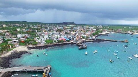 Aerial view of San Cristobal island coast, boats in harbour, Puerto Baquerizo Moreno harbor, Galapagos, Ecuador