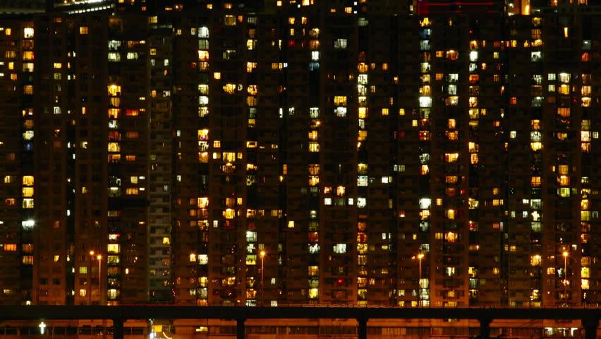Time lapse of High-density apartment block at night, Hong Kong.