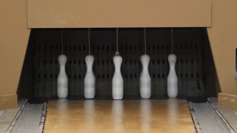 Bowling ball going into the pins. Nine Pin Bowling. five out of nine cones fall over