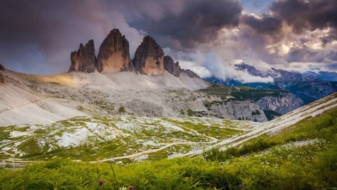 Foggy view of the National park Tre Cime di Lavaredo. Dramatic scene. Location place Dolomiti alps, Tyrol, Italy, Europe. Popular tourist attraction. Beauty world. Time lapse clip, interval shooting.