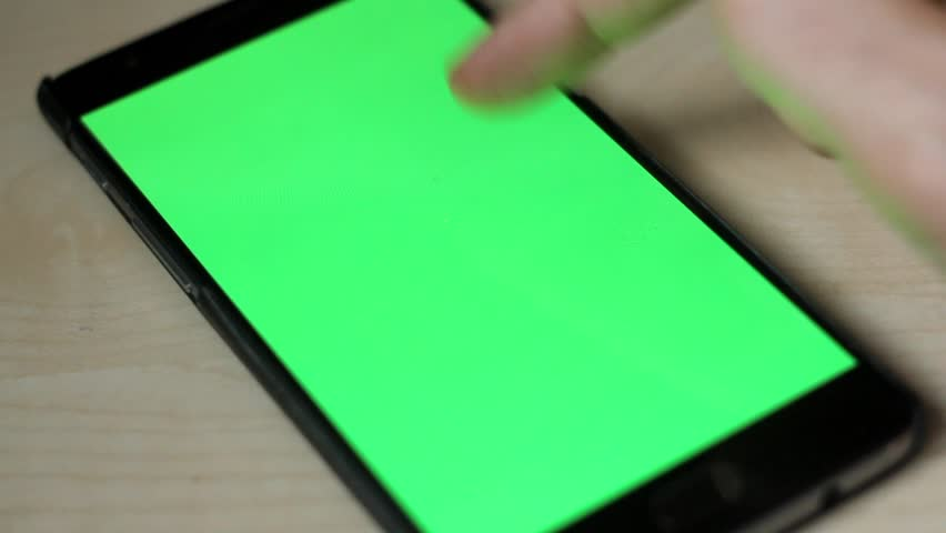 MARCH 2017 - LONDON UK - Unlocking a mobile phone onto a GREEN SCREEN then swiping VERTICALLY #24813056