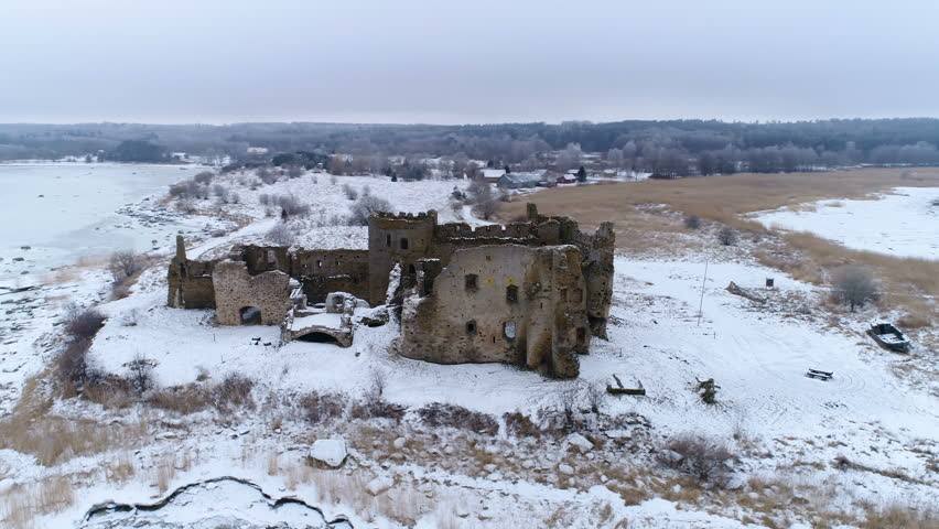 The panoramic view of the old Toolse castle with the snow filled on a winter season in Estonia