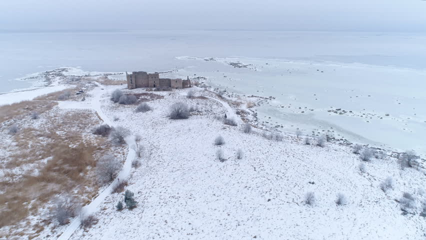 The frozen icey ground surropunding the Toolse castle found in Lahemaa Estonia on a winter season
