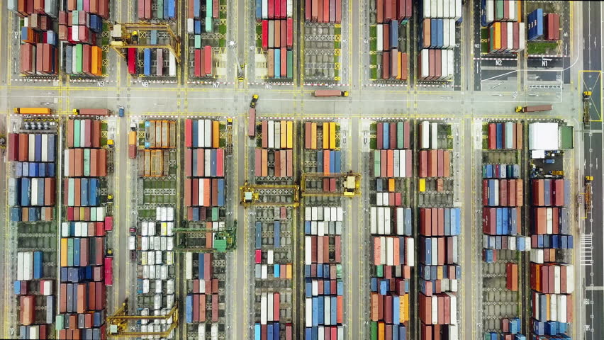 Overhead drone footage of shipping containers with transport network trucks, seamless transport routes supply chain | Shutterstock Video #24864011