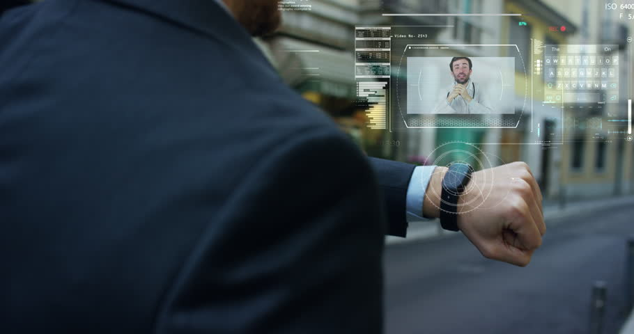 Man elegant suit responds, with the phone high technology with holography and augmented reality, to the doctor for treatment.  | Shutterstock HD Video #24937766