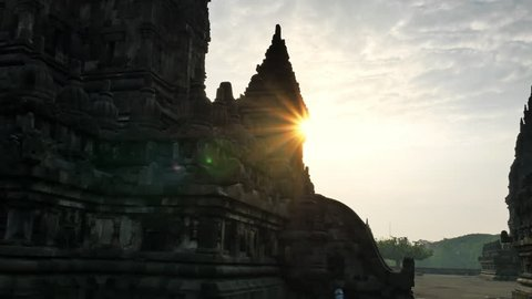Beautiful silhouettes of Prambanan temple with bright sun light shining over ancient Hindu complex in central Java, Indonesia