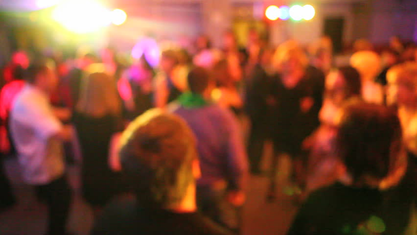 crowd of smart people dancing in disco lights