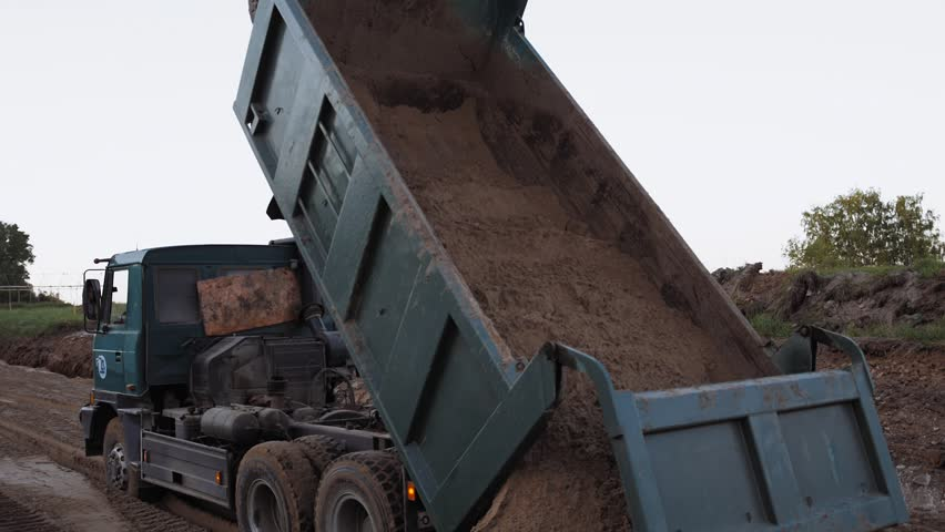 Heavy Duty Dump Truck Dumping Soil Road Works