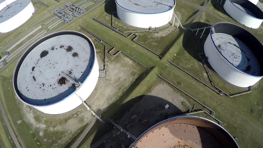 Aerial top down view oil depot sometimes called tank farm or oil terminal is industrial facility for storage of oil and petrochemical products ready for transport to further storage facilities 4k
