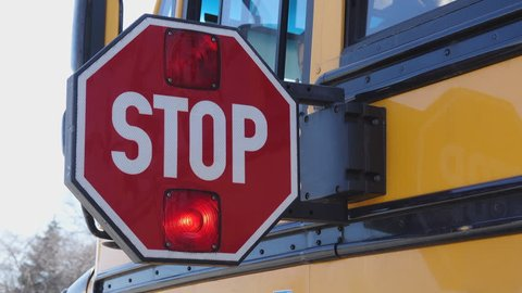 School bus stop paddle being turned off