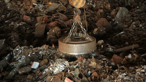 Scrap metal recycling. Magnet tablet transport scrap metal. Metal recycle process. Recycling metal crane. Steel industry crane