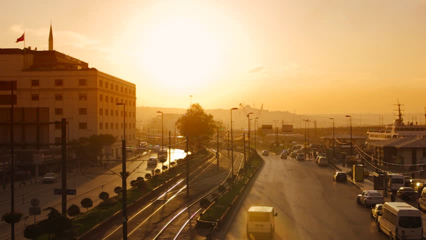 View to the Eminonu port and Ragip Gumuspala street at sunset in Istanbul, Turkey.
