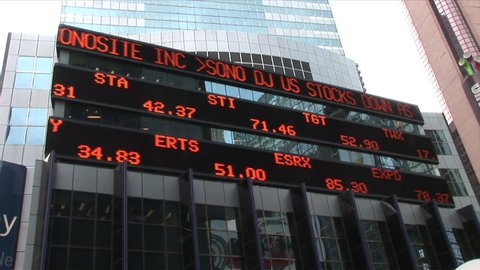 New York, NY - CIRCA March 2006: A wide shot of an electronic billboard that scrolls the days current stock prices