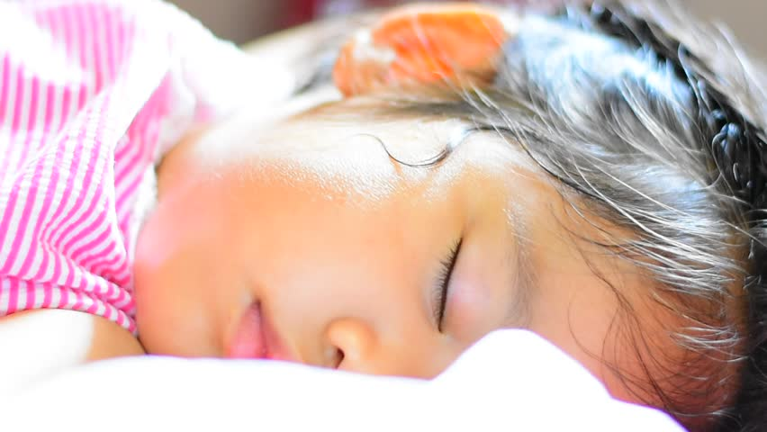 The child is sleeping happily.   Shutterstock HD Video #25000256