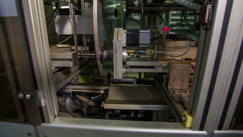 We can see lots of machinery in a factory. There are many different equipment and wires.   Shutterstock HD Video #25007666