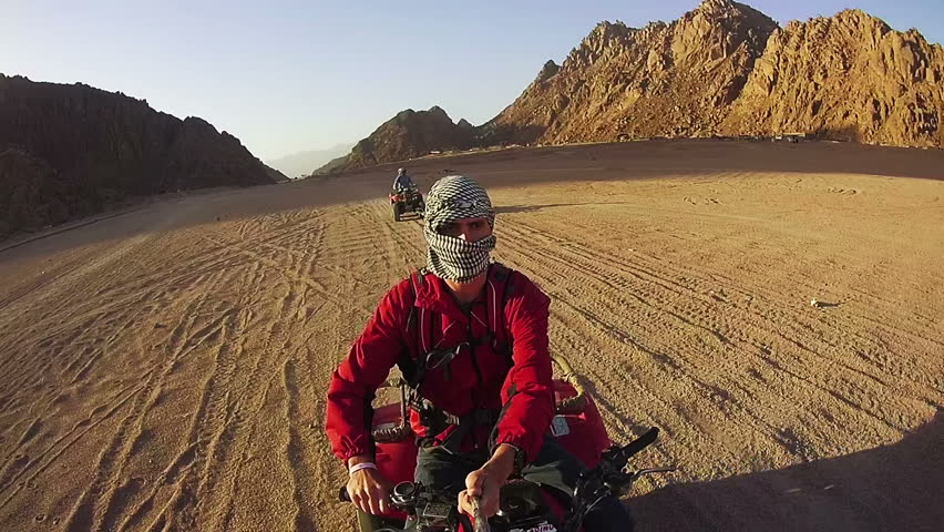 Driving ATVs in the Desert of Egypt. Riding on Quad Bikes in the Desert of Egypt. Adventures of desert off-road on ATVs. First-person view on action camera. | Shutterstock HD Video #25008986