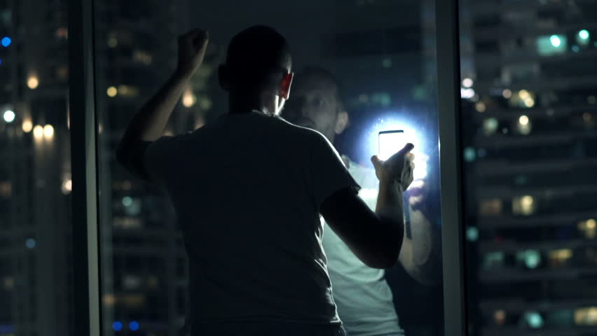 Imprisoned, terrified man sending SOS signal with phone in bedroom at night  #25030586