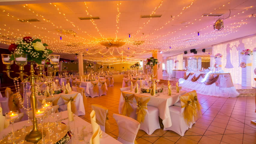 Wedding Hall Interior Decoration With Table Decorations Flowers And